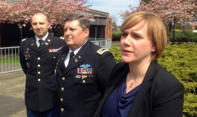 Capt. Matt Aiesi, Maj. Greg Malson and civilian Emma Scanlan, attorneys for Staff Sgt. Robert Bales, speak with reporters at Joint Base Lewis-McChord, Wash., Tuesday, April 23, 2013, following a hearing in his case. Bales could face the death penalty if convicted of massacring 16 Afghan villagers in Kandahar Province last March. (AP Photo/Gene Johnson)