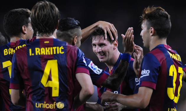 FC Barcelona's Lionel Messi from Argentina, second right, reacts after scoring against Elche during a Spanish La Liga soccer match at the Camp Nou stadium in Barcelona, Spain, Sunday, Aug. 24, 2014. (AP Photo/Manu Fernandez)