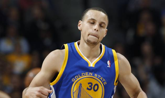 Golden State Warriors guad Stephen Curry reacts after hitting a basket in the fourth quarter of the Warriors' 131-117 victory over the Denver Nuggets in Game 2 of the teams' NBA first-round playoff series in Denver on Tuesday, April 23, 2013. (AP Photo/David Zalubowski)