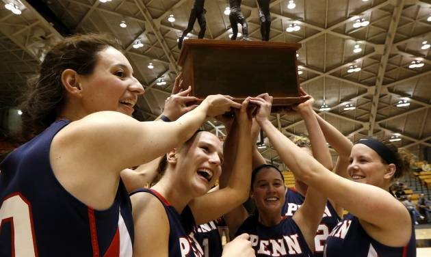 Members of the Penn women's basketball team celebrate after beating Princeton 80-64 for the Ivy League title during an NCAA college basketball game, Tuesday, March 11, 2014, in Princeton, N.J. (AP Photo/Julio Cortez)