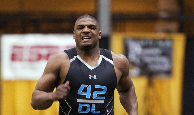 Missouri defensive lineman Michael Sam crosses the finish line while running the 40-yard dash during pro day for NFL football representatives Thursday, March 20, 2014, in Columbia, Mo. (AP Photo/L.G. Patterson)