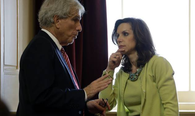 State Sen. Richard Saslaw, D-Fairfax, left, talks with Sen. Jill Vogel, R-Fauquier, during debate on the transportation funding bill at the Capitol in Richmond, Va., Saturday, Feb. 23, 2013.  The Senate passed the measure.   (AP Photo/Steve Helber)