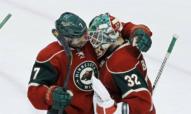 Minnesota Wild center Matt Cullen, left, congratulates Minnesota Wild goalie Niklas Backstrom (32), of Finland, after the Wild beat the Los Angeles Kings 2-1 in an NHL hockey game in St. Paul, Minn., Tuesday, April 23, 2013.(AP Photo/Ann Heisenfelt)
