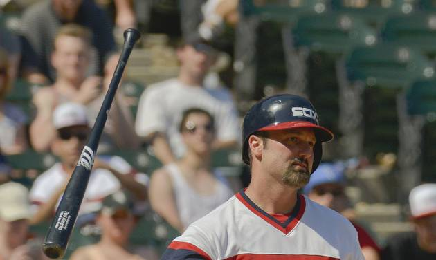Chicago White Sox' Paul Konerko flips his bat after being called out on strikes in the sixth inning of a baseball game against the San Diego Padres on Saturday, May 31, 2014, in Chicago. (AP Photo/Matt Marton)
