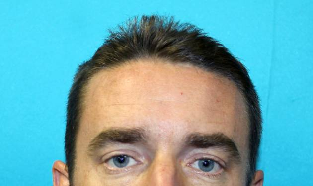 "This handout photo provided by the Richland Hills Police Department shows Brent Troy Bartel. Richland Hills, Texas.  Police said Bartel carved a pentagram into his 6-year-old son's back Wednesday, telling a 911 dispatcher that he did it because ""it's a holy day.""  Brent Troy Bartel was charged with aggravated assault with a deadly weapon.  (AP Photo/Richland Hills Police Department)"