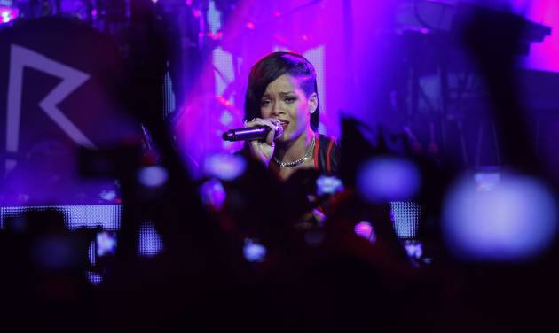 Barbadian singer Rihanna performs during the first stop of her 777 worldwide tour at the Plaza Condesa in Mexico City, Wednesday, Nov. 14, 2012. (AP Photo/Marco Ugarte)