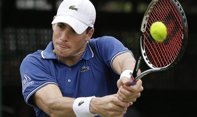 John Isner of the USA returns to opponent Ivo Karlovic of Croatia during a quarterfinal match at the Hall of Fame Tennis Championships in Newport, R.I. Friday, July 12, 2013. Isner won 7-6 (3), 7-6 (3). (AP Photo/Elise Amendola)