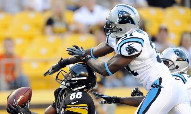 Pittsburgh Steelers wide receiver Emmanuel Sanders (88) makes a catch past Carolina Panthers defensive back Reggie Smith (31) for a touchdown in the first quarter of their NFL preseason football game, Thursday, Aug. 30, 2012, in Pittsburgh. (AP Photo/Don Wright)
