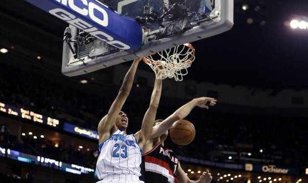 New Orleans Hornets forward Anthony Davis (23) dunks in front of Portland Trail Blazers forward Joel Freeland, guard Ronnie Price (24) and center Meyers Leonard (11) in the second half of an NBA basketball game in New Orleans, Wednesday, Feb. 13, 2013. The Hornets won 99-63. (AP Photo/Gerald Herbert)