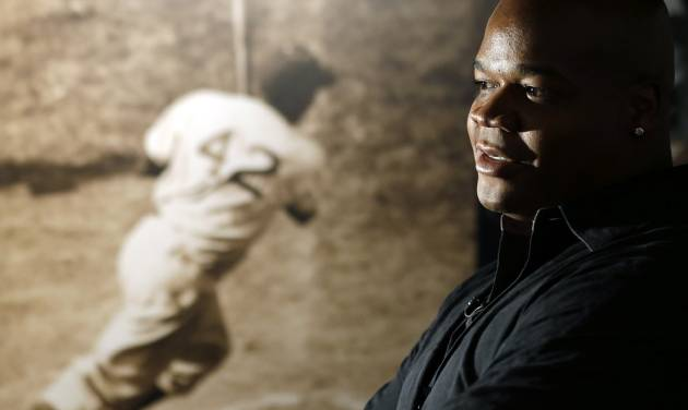 Former Chicago White Sox player Frank Thomas visits a Jackie Robinson exhibit during his orientation visit at the Baseball Hall of Fame on Monday, March 3, 2014, in Cooperstown, N.Y. Thomas will be inducted to the hall in July. (AP Photo/Mike Groll)