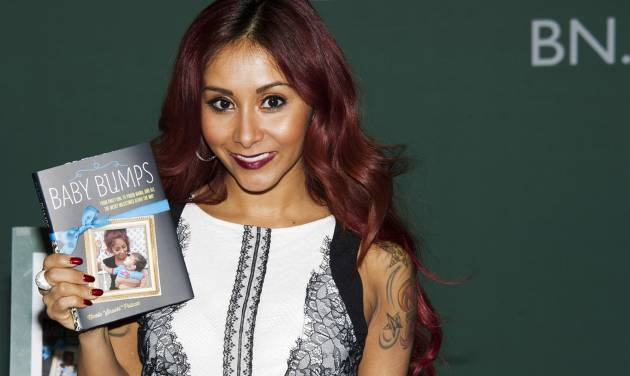 """FILE - In this Jan. 15, 2014 photo, Nicole """"Snooki"""" Polizzi appears at a signing event for her book """"Baby Bumps"""" at Barnes & Noble in New York.  Polizzi is expecting baby No. 2. The 26-year-old reality star says in an interview with Us Weekly: """"I'm due in the fall around my wedding time. Busy year!"""" The pregnancy was confirmed by her publicist. Polizzi and her fiance, Jionni LaValle, are the parents of 19-month-old Lorenzo.  (Photo by Charles Sykes/Invision/AP)"""
