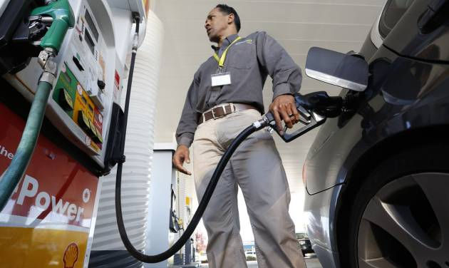 FILE - In this file photo taken Friday March 7, 2014, Eric Henry gases up his car in Sacramento, Calif. Drivers will get the slightest of breaks on gasoline prices this summer, according to the Energy Department. The national average price is forecast to fall — by just one cent — to $3.57 per gallon between April and September, the months when Americans do most of their driving. (AP Photo/Rich Pedroncelli, File)