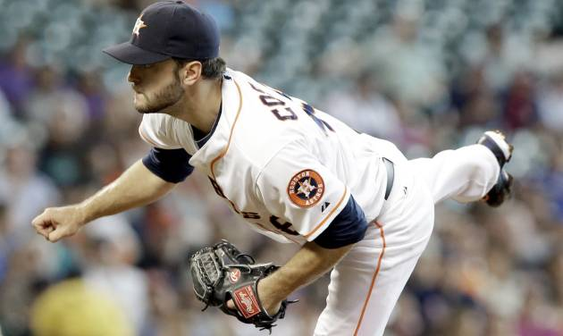 Houston Astros' Jarred Cosart follows through on a pitch against the Atlanta Braves in the third inning of a baseball game Thursday, June 26, 2014, in Houston. (AP Photo/Pat Sullivan)