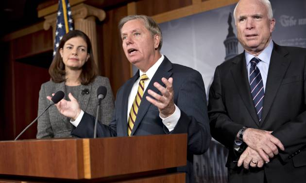 Sen. John McCain, R-Ariz., ranking Republican on the Senate Armed Services Committee, right, and fellow committee member Sen. Kelly Ayotte, R-N.H., left, listen as Sen. Lindsey Graham, R-S.C., center, speaks during a news conference on Capitol Hill in Washington, Wednesday, Nov. 14, 2012, saying says he would do all he could to block the nomination of United Nations Ambassador Susan Rice to replace Secretary of State Hillary Rodham Clinton because of comments she made after the deadly Sept. 11 attack on the U.S. consulate in Benghazi. (AP Photo/J. Scott Applewhite)