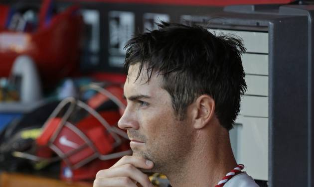Philadelphia Phillies starting pitcher Cole Hamels rests in the dugout in the fourth inning of a baseball game against the Cincinnati Reds, Friday, June 6, 2014, in Cincinnati. (AP Photo/Al Behrman)