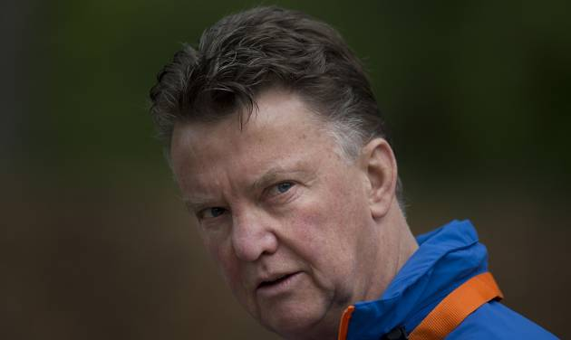 FILE - In this Thursday, May 15, 2014 file photo, Louis Can Gaal, coach of the Dutch national soccer team walks towards the mixed zone after a team training in Hoenderloo, eastern Netherlands. Manchester United has hired Netherlands coach Louis Van Gaal as the club's new manager it was announced on Monday, May 19, 2014. Van Gaal, who will leave his position with the Dutch after the upcoming World Cup in Brazil, replaces David Moyes following his firing last month after just 10 months in charge.  (AP Photo/Peter Dejong, File)