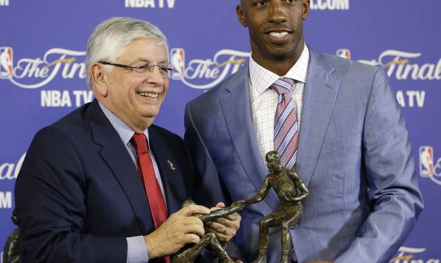 NBA Commissioner David Stern, left, presents Chauncey Billups of the L.A. Clippers with the 2012-2013 Twyman-Stokes Teammate of the Year Award before the start of Game 2 of the NBA Finals basketball game between the Miami Heat and the San Antonio Spurs, Sunday, June 9, 2013 in Miami. The newly created NBA award recognizes the league's ideal teammate. Billups was selected by a panel of 12 NBA legends. (AP Photo/Wilfredo Lee)