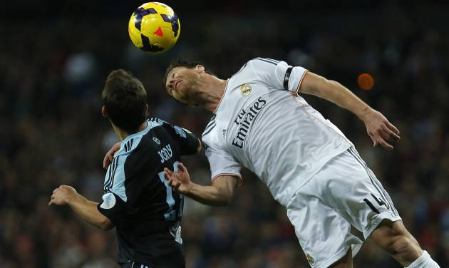 Real Madrid's Xabi Alonso, left, in action with Celta's Jonathan Castro 'Jonny', right, during a Spanish La Liga soccer match between Real Madrid and Celta at the Santiago Bernabeu stadium in Madrid, Spain, Monday, Jan. 6, 2014. (AP Photo/Andres Kudacki)