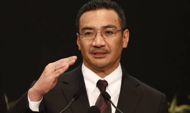 Malaysia's acting Transport Minister Hishammuddin Hussein answers a reporter's questions during a press conference for the missing Malaysia Airline, flight MH370, at Putra World Trade Centre (PWTC) in Kuala Lumpur, Malaysia, Tuesday, March 25, 2014. China demanded that Malaysia turn over the satellite data used to conclude that a Malaysia Airlines jetliner had crashed in the southern Indian Ocean, killing everyone on board, as gale-force winds and heavy rain on Tuesday halted the search for remains of the plane. (AP Photo/Vincent Thian)