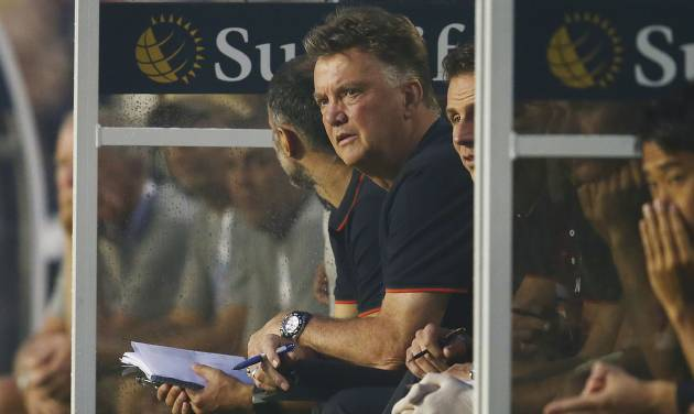 Manchester United Louis Van Gaal watches first half game action against Liverpool during the finals of the Guinness International Championship Cup soccer match in Miami, Gardens, Fla., Monday, July 4, 2014. (AP Photo/J Pat Carter)