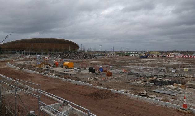 In this Sunday, Feb. 23, 2014 photo, a view of the construction site in Queen Elizabeth Olympic Park in east London. The Games' Velodrome is seen left. London continues to bask in the success of the most recent Summer Games, but the Olympic legacy is difficult to determine. The flagship venue, renamed the Queen Elizabeth Olympic Park, is being converted into a massive park as big as London's famous Hyde Park, complete with wildlife habitats, woods and sports facilities. The first part of the ambitious project will begin to open to the public in April. The 80,000-seat Olympic Stadium at the center of the park has been troubled by controversy since even before the games, and its post-games use was the subject of months of legal wrangling. The stadium is now being converted into a soccer venue and the home of the West Ham soccer club, with an expected price tag of $323 million. Many argue taxpayers should not have to fund a Premier League club, though officials insist that the stadium will continue to host other major sporting events, including the Rugby World Cup in 2015. (AP Photo/Lefteris Pitarakis)