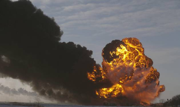 FILE - In this Dec. 30, 2013 file photo, a fireball goes up at the site of an oil train derailment in Casselton, N.D.  A new Minnesota law aims to protect the state from hazards created by increasing amounts of oil passing through Minnesota by rail and pipeline. Gov. Mark Dayton signed the bill Tuesday, May 20, 2014. The law requires railroad and oil pipeline companies operating in Minnesota to help pay for training and emergency preparedness programs. (AP Photo/Bruce Crummy, File)