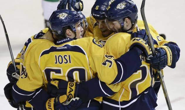 Nashville Predators defenseman Roman Josi (59), of Switzerland, celebrates with Shea Weber (6) and Paul Gaustad (28) after Josi scored against the Dallas Stars in the second period of an NHL hockey game Monday, Jan. 20, 2014, in Nashville, Tenn. (AP Photo/Mark Humphrey)