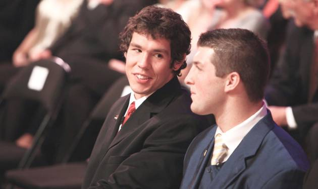 Oklahoma's Sam Bradford, left chats with Florida's Tim Tebow during the Heisman Trophy presentation ceremony Saturday. AP Photo