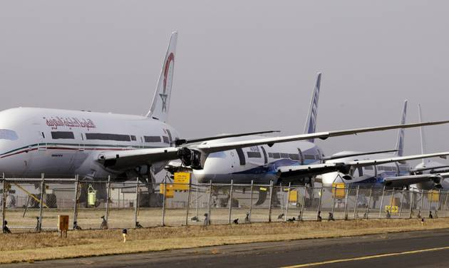 A line of 787 jets are parked Thursday, Jan. 17, 2013, at Paine Field in Everett, Wash. Federal officials say they are temporarily grounding Boeing's 787 Dreamliners until the risk of possible battery fires is addressed. The Federal Aviation Administration said Wednesday it will issue an emergency safety order requiring U.S. airlines to temporarily cease operating the 787, Boeing's newest and most technologically advanced plane. (AP Photo/Elaine Thompson)