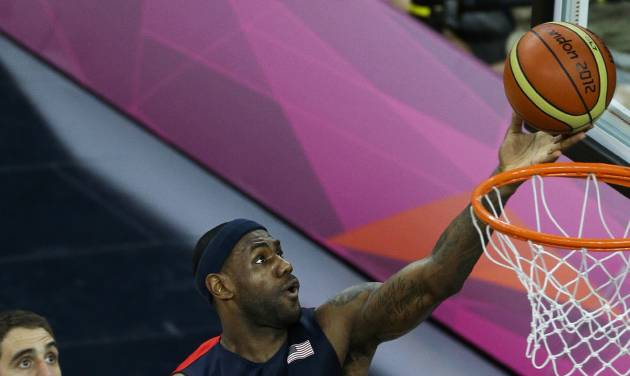 United States' Lebron James (6) shoots for the basket past Argentina's Juan Gutierrez, left, and Argentina's Luis Scola, bottom, during a men's basketball semifinal game at the 2012 Summer Olympics, Friday, Aug. 10, 2012, in London. (AP Photo/Victor R. Caivano)