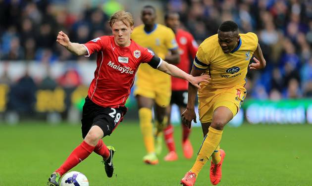 Crystal Palace's Kagisho Dikgacoi, right, and Cardiff City's Mats Daehli battle for the ball during their English Premier League soccer match at Cardiff City Stadium, Cardiff, Saturday April 5, 2014. (AP Photo/PA, Nick Potts) UNITED KINGDOM OUT  NO SALES  NO ARCHIVE