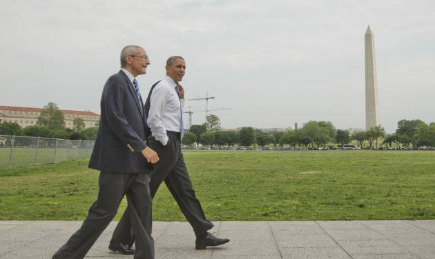 President Barack Obama and White House counselor John Podesta, left, walk across the ellipse in Washington as they head towards the Dept. of Interior, Wednesday, May 21, 2014. Obama and Podesta also walked back to the White House after a signing a proclamation regarding the Organ Mountains-Desert Peaks National Monument. (AP Photo/Pablo Martinez Monsivais)