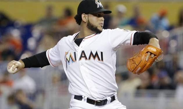 Miami Marlins' Henderson Alvarez delivers a pitch during the first inning of a baseball game against the New York Mets, Monday, Sept. 1, 2014 in Miami. (AP Photo/Wilfredo Lee)