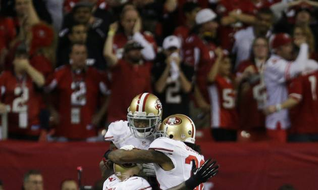San Francisco 49ers' NaVorro Bowman, Darcel McBath and LaMichael James celebrate as time runs out in the second half of the NFL football NFC Championship game against the Atlanta Falcons Sunday, Jan. 20, 2013, in Atlanta. The 49ers won 28-24 to advance to Superbowl XLVII. (AP Photo/Dave Martin)