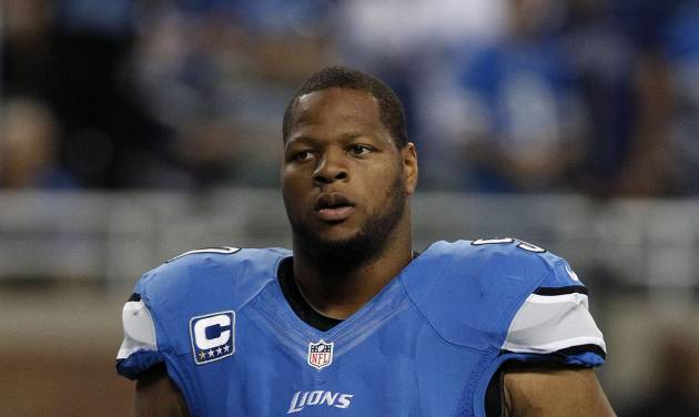 FILE - In this Sept. 8, 2013 file photo, Detroit Lions defensive tackle Ndamukong Suh (90)  walks on the field before an NFL football game against the Minnesota Vikings at Ford Field in Detroit. The NFL is looking into possibly disciplining Suh for his latest on-field infraction. League spokesman Randall Liu confirmed the review on Monday, Sept. 9, 2013, in an email to The Associated Press. Suh, a defensive tackle, was called for an illegal low block against Minnesota center John Sullivan during an interception return Sunday.(AP Photo/Duane Burleson, File)