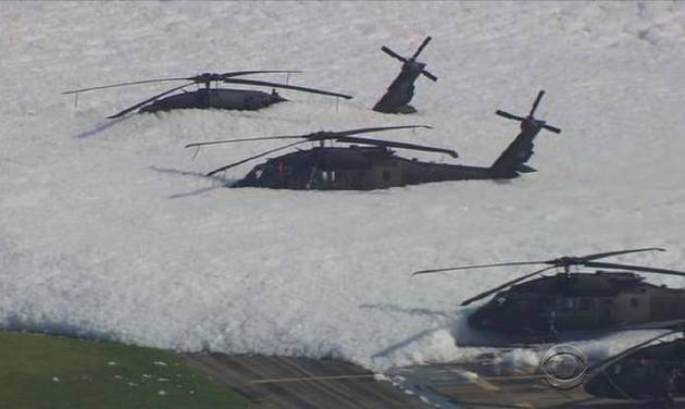 Anti-fire foam covers Black Hawk helicopters at an Army National Guard base in Tulsa, Okla. -- CBS News