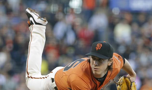 San Francisco Giants starting pitcher Tim Lincecum throws in the second inning of their baseball game against the Arizona Diamondbacks, Friday, July 11, 2014, in San Francisco. San Francisco won the game 5-0 and Lincecum was the winning pitcher. (AP Photo/Eric Risberg)