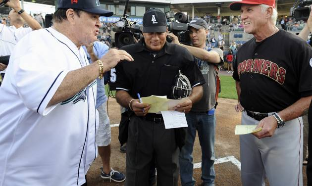 Pete Rose, left, and Lancaster Barnstormers manager Butch Hobson, right, talk at home plate before a game at The Ballpark at Harbor Yard, Monday, June 16, 2014, in Bridgeport, Conn. Rose, banned from Major League Baseball, returned to the dugout for one day to manage the independent minor-league Bridgeport Bluefish. (AP Photo/Jessica Hill)