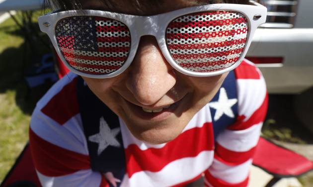 Michelle Whyte, 34, of Hoboken, N.J., wears the United States colors on her sunglasses and shirt while tailgating before the start of an international soccer friendly between Turkey and the United States, Sunday, June 1, 2014, in Harrison, N.J. (AP Photo/Julio Cortez)