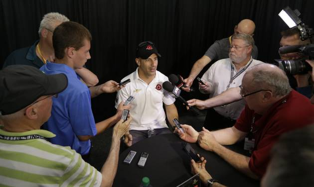 Tony Kanaan, of Brazil, responds to a question during a media interview for the Indianapolis 500 IndyCar auto race at the Indianapolis Motor Speedway in Indianapolis, Thursday, May 22, 2014. (AP Photo/Darron Cummings)
