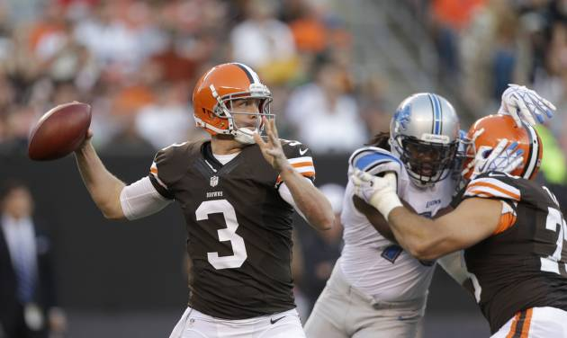 """FILE - In this Aug. 15, 2013 file photo, Cleveland Browns quarterback Brandon Weeden passes in a preseason NFL football game against the Detroit Lions the Detroit Lions in Cleveland. Weeden was named Cleveland's starting quarterback on Tuesday, Aug. 20, 2013, ending a """"competition"""" set up by Browns first-year coach Rob Chudzinski, who wanted to push the QB to bring out the best in him. (AP Photo/Tony Dejak, File)"""