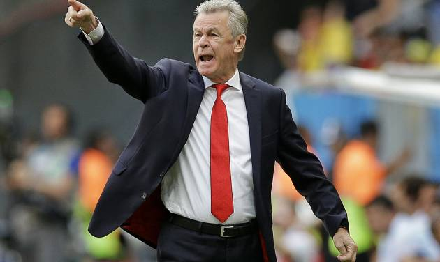 Switzerland's coach Ottmar Hitzfeld shouts from the touchline during the group E World Cup soccer match between Switzerland and Ecuador at the Estadio Nacional in Brasilia, Brazil, Sunday, June 15, 2014. (AP Photo/Michael Sohn)