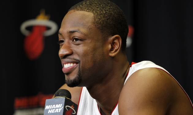 Miami Heat basketball player Dwyane Wade speaks during the team's NBA media day in Miami, Friday, Sept. 28, 2012. (AP Photo/Marta Lavandier)
