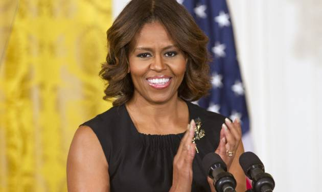 "First lady Michelle Obama applauds in the East Room of the White House in Washington, Wednesday, June 4, 2014, during a Joining Forces initiative event to announce ""The Mayors Challenge to End Veteran Homelessness"" program. (AP Photo/Jacquelyn Martin)"