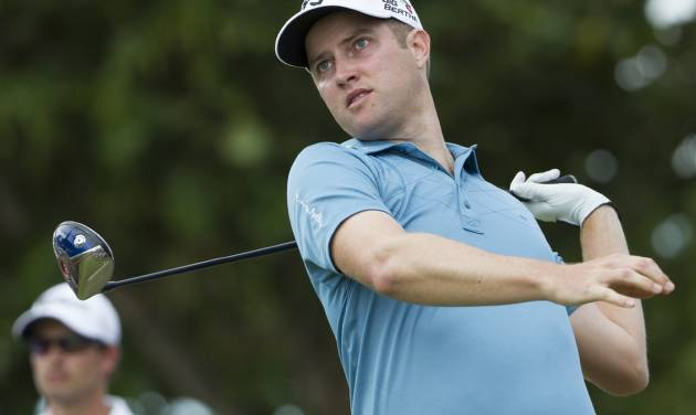 Chris Kirk watches his drive off the 12th tee during the third round of the Sony Open golf tournament at Waialae Country Club, Saturday, Jan. 11, 2014, in Honolulu. (AP Photo/Eugene Tanner)
