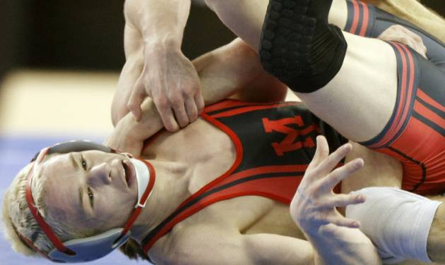 Yukon's Boo Lewallen wrestles Sand Spring's Cody Karstetter in a semifinal 126 pound match in the Class 6A state wrestling tournament at Jim Norick Arena at State Fair Park in Oklahoma City, Friday, Feb., 28, 2014. Photo by Bryan Terry, The Oklahoman