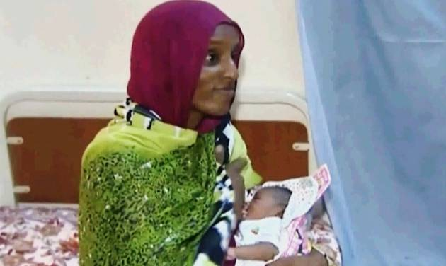 FILE - In this file image made from an undated video provided Thursday, June 5, 2014, by Al Fajer, a Sudanese nongovernmental organization, Meriam Ibrahim breastfeeds her newborn baby girl that she gave birth to in jail last week, as the NGO visits her in a room at a prison in Khartoum, Sudan. Sudan's official news agency, SUNA, said the Court of Cassation in Khartoum on Monday, June 23, canceled the death sentence against 27-year-old Meriam Ibrahim after defense lawyers presented their case. The court ordered her release. (AP Photo/Al Fajer, File)