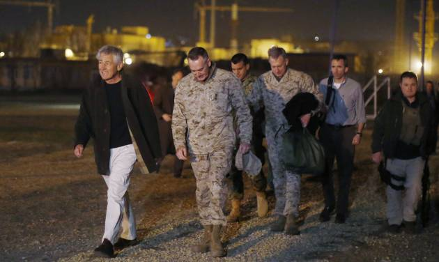 Defense Secretary Chuck Hagel walks with U.S. Marine General Joseph Dunford, commander of the International Security Force, upon Hagel's arrival near Camp Eggers in Kabul, Afghanistan, Friday, March 8, 2013. Hagel arrived in Afghanistan Friday for his first visit as Pentagon chief, saying that there are plenty of challenges ahead as NATO hands over the country's security to the Afghans. (AP Photo/Jason Reed, Pool)