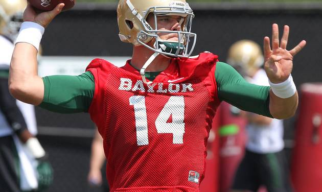 Baylor quarterback Bryce Petty looks downfield while throwing on the first day of NCAA college football practice, Tuesday, Aug. 5, 2014, in Waco, Texas. (AP Photo/Waco Tribune Herald, Jerry Larson)
