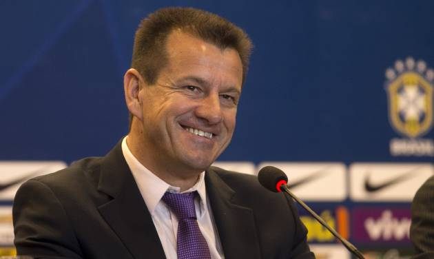 Brazil's soccer coach Dunga smiles during a press conference in Rio de Janeiro, Brazil, Tuesday, Aug. 19, 2014. Dunga summoned players for the upcoming friendly games against Colombia and Ecuador, the first time he picked players since taking over the national team from Luiz Felipe Scolari after the World Cup. (AP Photo/Silvia Izquierdo)